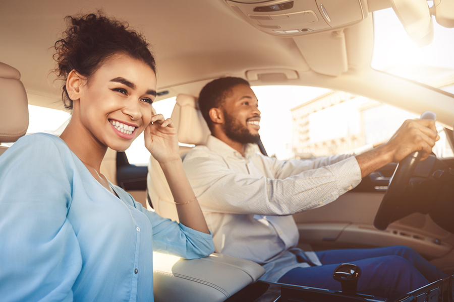 Personal Insurance - Young Couple Going for a Drive in Their New Car on a Sunny Afternoon