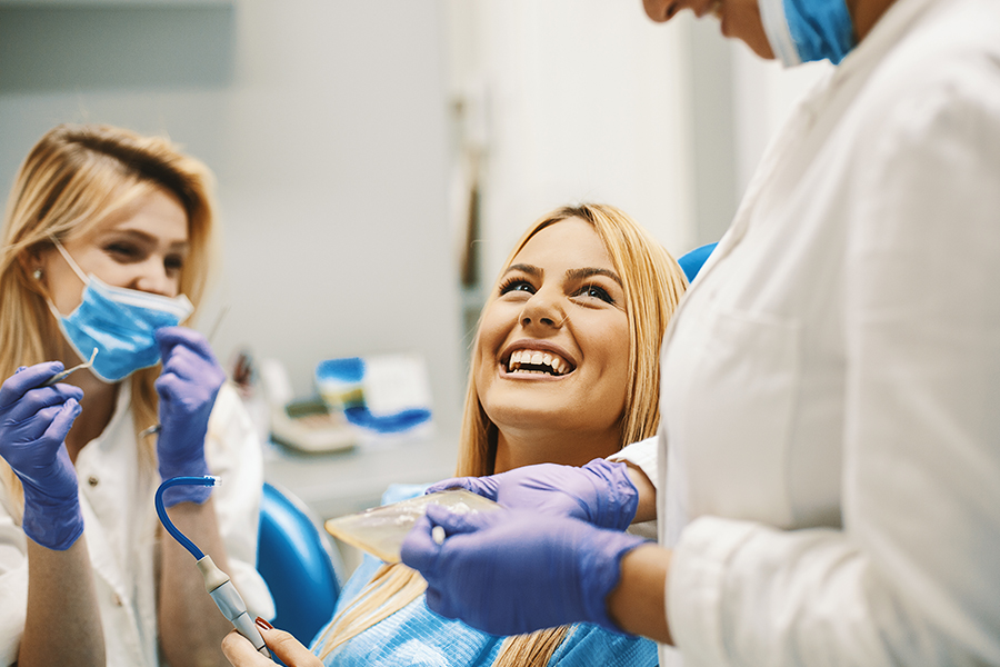 Specialized Business Insurance - Woman Smiling at Dentist Office Before Getting Her Teeth Cleaned